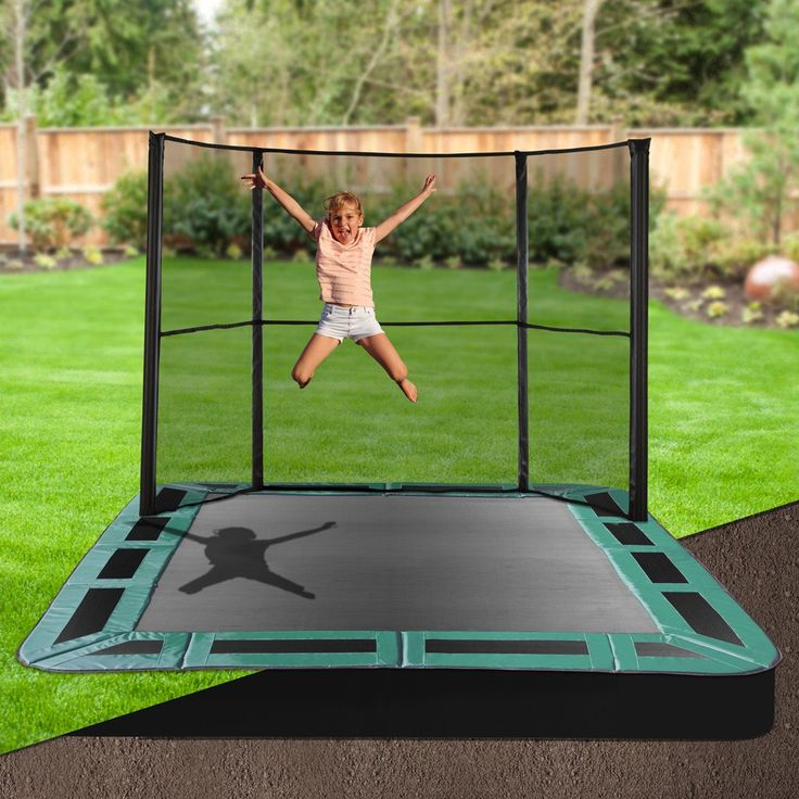 Keep your backyard looking stylish whilst letting the kids have fun on an Oz Trampolines inground trampoline. Available with half or full enclosures they are the perfect backyard accessory. #oztrampolines #trampolines #inground #backyard #play #outdoor