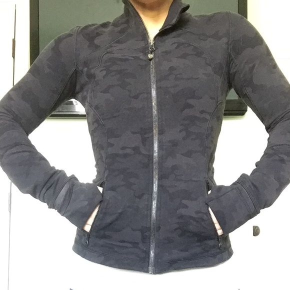Lululemon Black Camo Define Jacket No longer available in stores or online!!! This define jacket is made from cottony soft Luon fabric. Form fitting yet flattering, this jacket comes with thumb holes and cuffins (you can cover your hands)- keeping you warm when needed! The back detailing is designed with a round hem- giving your tush a slimmer look. lululemon athletica Jackets & Coats