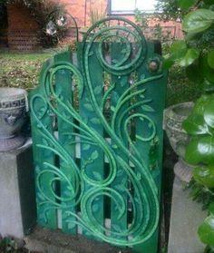 Refurbished garden hose makes a great gate decor or art piece