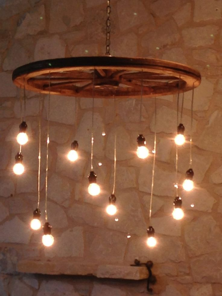 Random Length Wagon Wheel Chandelier (large) by RusticChandeliers on Etsy