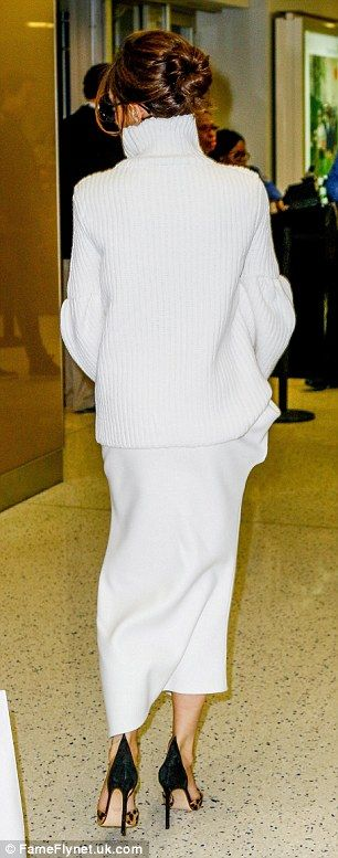 Victoria Beckham wears white jumper with oversized arms to leave JFK