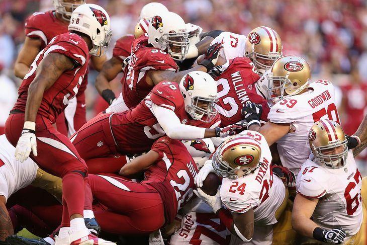 San Fransisco 49ers Dixon is tackled by Arizona Cardinals defense https://www.fanprint.com/licenses/arizona-cardinals?ref=5750