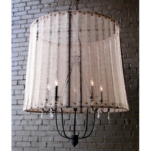 "The San Miguel Chandelier w/ Shade is a fine lighting fixture that does more than light a room — it illuminates. In the exceptional design and detailing, a fixture provides not just light, but charm and sophistication as well.  Solária offers a diverse line of specialty lighting products, all beautifully designed and carefully crafted in a distinctive, weathered European style.    Shade: Lamp Shade Olivia - Large w/Burlap/Jute   Shade Dimensions: 30""h x 36""w  Chain: 3 Feet"