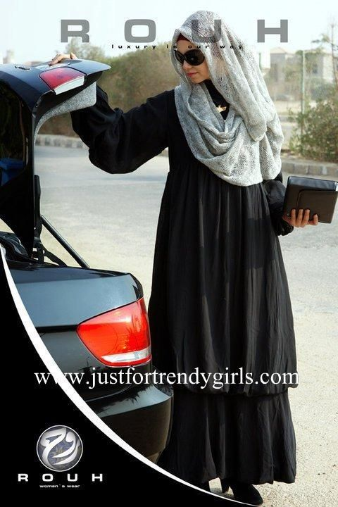 The long flowing abaya and the full draped hijab scarf are lovely, feminine, beautiful...!