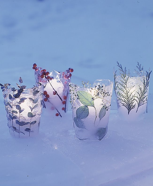 A collection of ice votives lining a stone wall will warmly welcome guests to a winter gathering. The flickering candlelight silhouettes the greenery and berries encased in the ice.