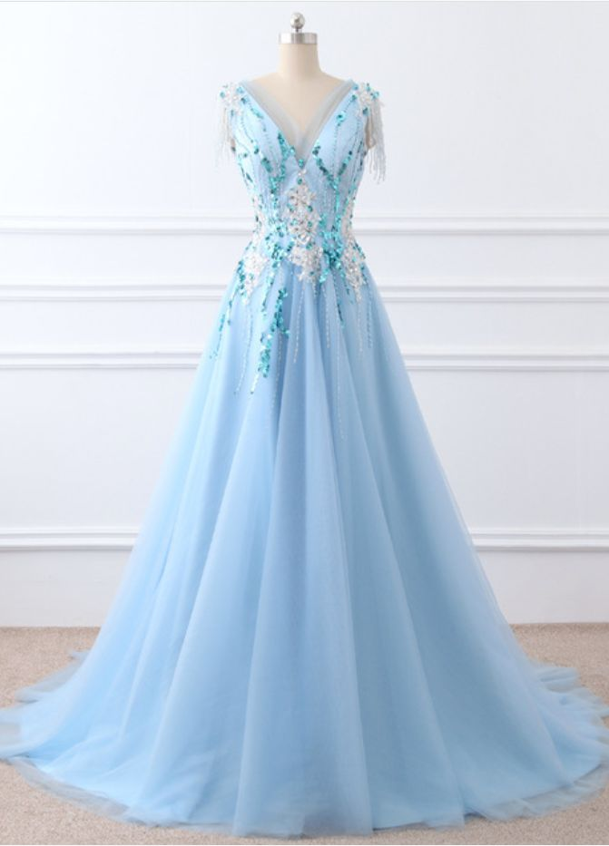 A light blue chiffon evening party V necker's formal evening gown with a high floor length gown