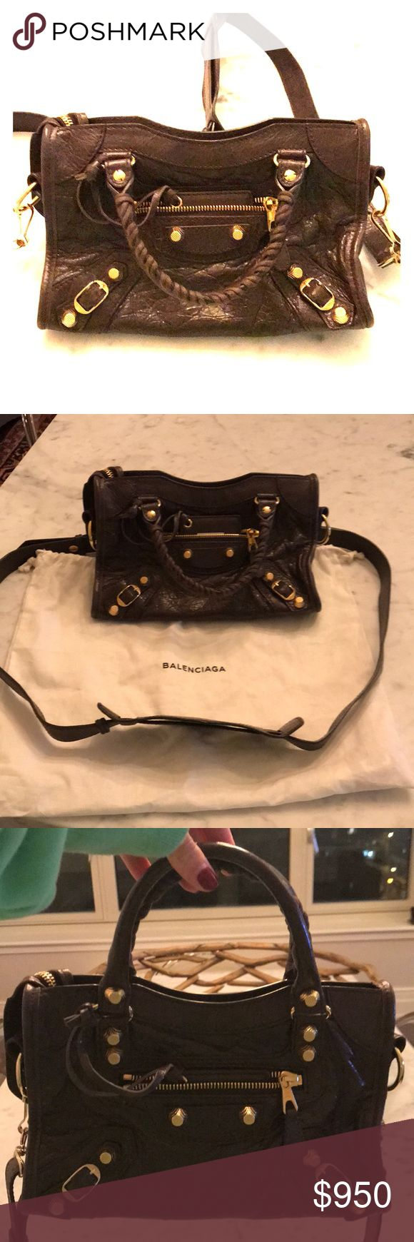 "CLASSIC GOLD NANO CITY BALENCIAGA Lambskin mini bag with ""classic"" shiny hardware:    Product details: Removable and adjustable shoulder strap • Top zip closure • Shiny gold metal hardware • Leather zipper pull • Front zip pocket • Interior zip pocket with Balenciaga embossed leather label • Leather framed mirror • Made in Italy   Dimensions: W 6.6 inches H 4.7 inches D 2.0 inches Composition:  Soft crafted vintage lambskin Lining: Black cotton canvas Balenciaga Bags Crossbody Bags"