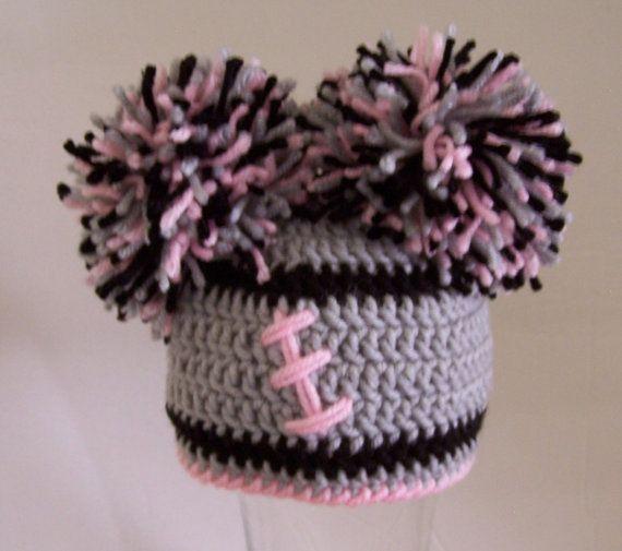 Crocheted baby girl football beanie
