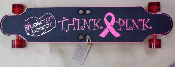 Our Think Pink Charity Board to raise funds for our local Breast Cancer Awareness Group.  Each purchase enables a 30 contribution in the name of the individual purchasing the board.  Boards are shipped free in the continental U.S.  32 Customized long board handmade in USA with durable recycled aluminum and plastic. 32 Long, 8 at its widest with a 1.75 drop. Weighs 8lbs.  featuring:  The KnuckleDuster system doubles as finger holes or as security feature. You can use them to help carry your…