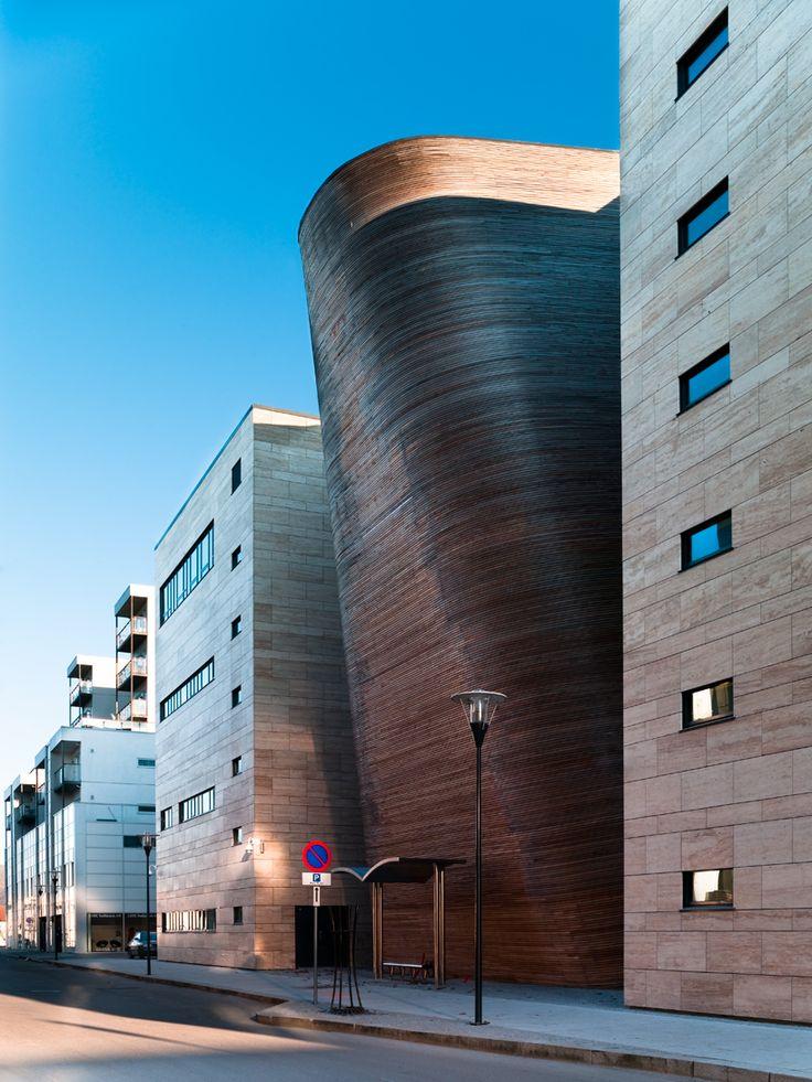 Vagen High School in Sandnes, Norway, by Link Arkitektur. Nice curved wood wall.