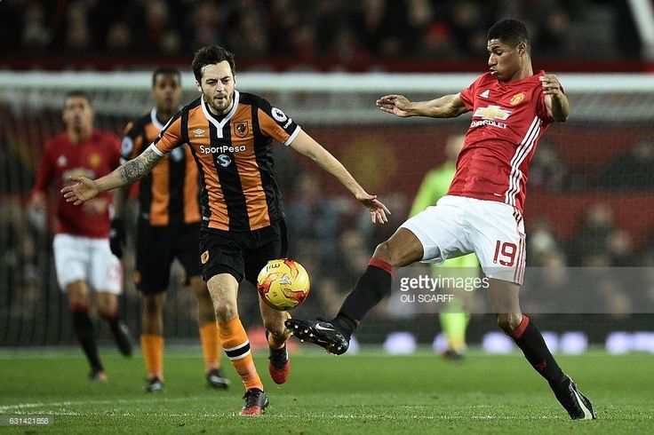 Manchester Uniteds English striker Marcus Rashford (R) controls the ball during the EFL (English Football League) Cup semi-final football match between Manchester United and Hull City at Old Trafford in Manchester, north west England on January 10, 2017. / AFP / Oli SCARFF / RESTRICTED TO EDITORIAL USE. No use with unauthorized audio, video, data, fixture lists, club/league logos or live services. Online in-match use limited to 75 images, no video emulation. No use in betting, games or...