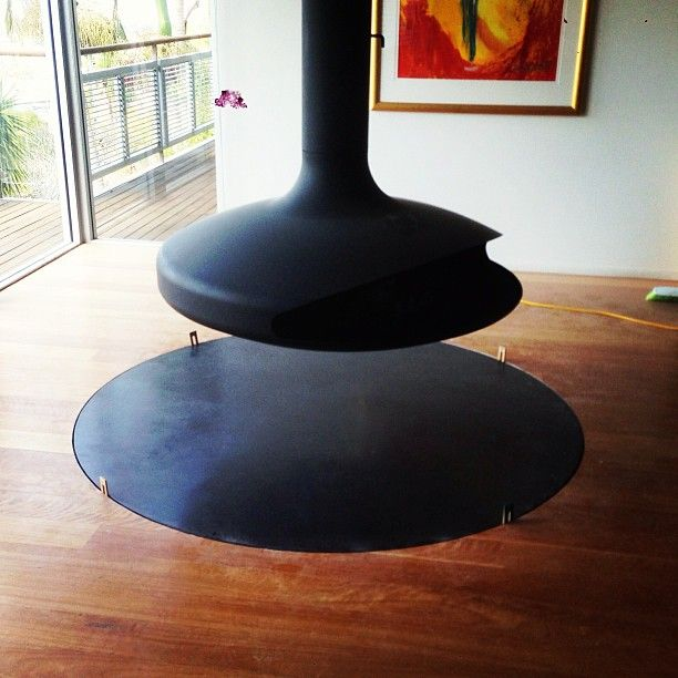 Black concrete fireplace hearth by POPconcrete