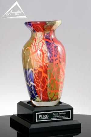 The Magnitude is a very special Art Glass Award or Gift. Art glass awards are handmade, and each award will be slightly different in size, shape and color. They are great options when you want to add really unique and colorful awards to your program.  The Magnitude is 11 inches tall.  It rests on (not adhered to) a black wood base that has a plate for engraving your award or gift text.  The Award is very popular for Management Awards, Thank You Gifts, Sponsor Awards, Speaker Gifts, Vendor…