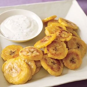 tostones Recipe from Fried plantains are a popular side dish in both Puerto Rico and the Dominican Republic. To reduce calories, oven-fry them and serve with a dipping sauce made with olive oil, minced garlic and salt & pepper!