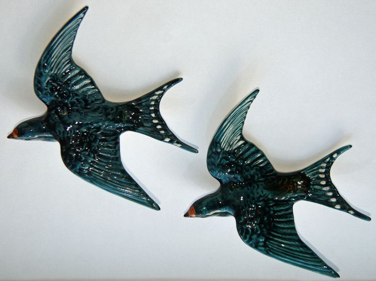 Pair of porcelain flying swallows by Beswick of England (now owned by Dartington Crystal), model number 757-1, manufactured between 1939 and 1973. Based on the backstamp, this particular pair were manufactured between 1950 and 1960.