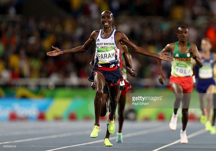 Mohamed Farah of Great Britain wins the Men's 10,000m on Day 8 of the Rio 2016…