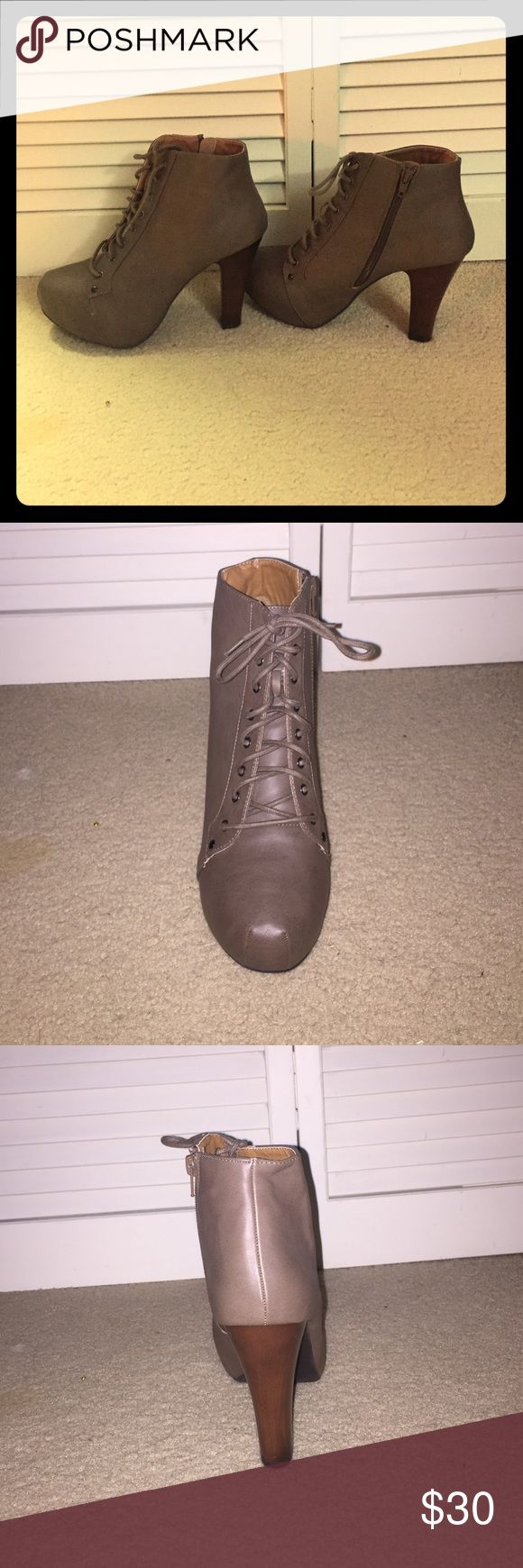 Brown Heeled Boots NEVER WORN! Approximately a 3-4 inch heel and lace-up front. Shoes Heeled Boots
