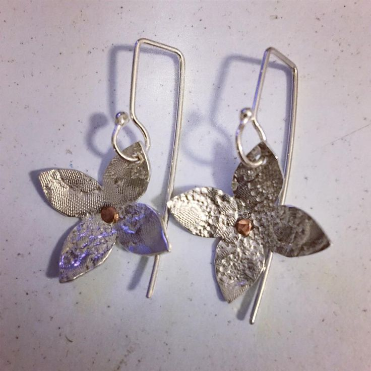 Balancing art with retail #flowers #handmade in #silver and #copper #simpledesign #elegant #feminine find them at #craftharvest and #lakehousearts