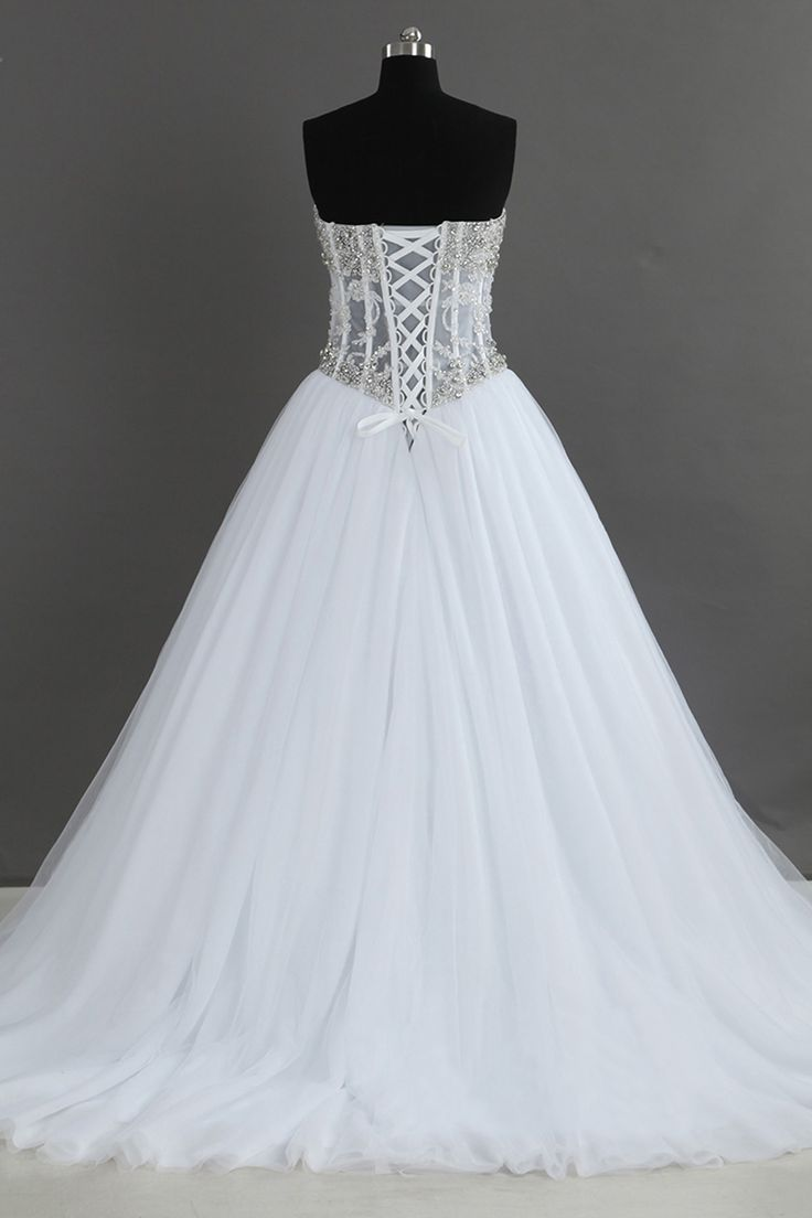 Tailor-Made 'Emerald' Wedding Gown £449.99 Established uk team of highly skilled dress makers We provide plus-size + petite! Custom-size (made to your measurements) @ no extra fee! Over 100 colours or send in a shade and we'll match it! Free uk delivery! And International postage offered! @ www.bespokebridaluk.com