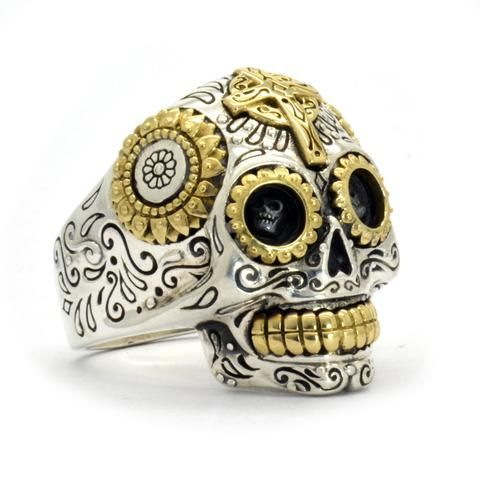 This Mexican Sugar Skull Ring is the end-all, be-all of biker skull rings! This totally badass ring is made from a full ounce of 925 Sterling silver with bright brass detailing. The intricate, Mexican