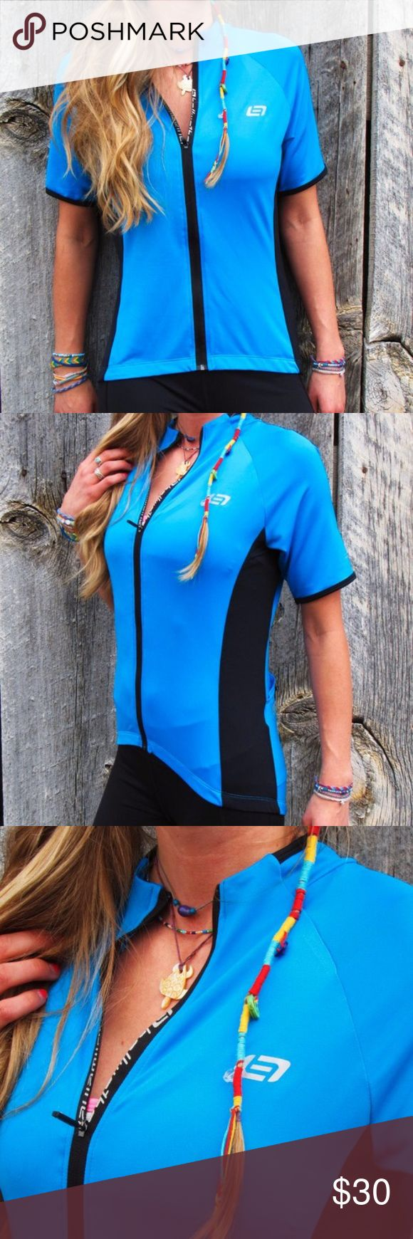 NEW Biker Blue Zip Up Jersey Tee This awesome biker blue workout zip up jersey tee by Bellwether is brand new. Made of the perfect combination of polyester & spandex this top has been fashioned to move with you for ultimate comfort. Reflective elements on both the front & back keep you visible & safe. This amazing royal blue top is longer in the back & sports 3 large pockets & 1 smaller zippered pocket. The bottom hem has a grippy strip to keep it from riding up as you work out. Tag says L…
