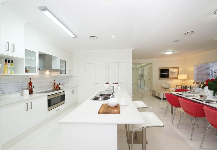 white cupboards, benchtop and glass splashback