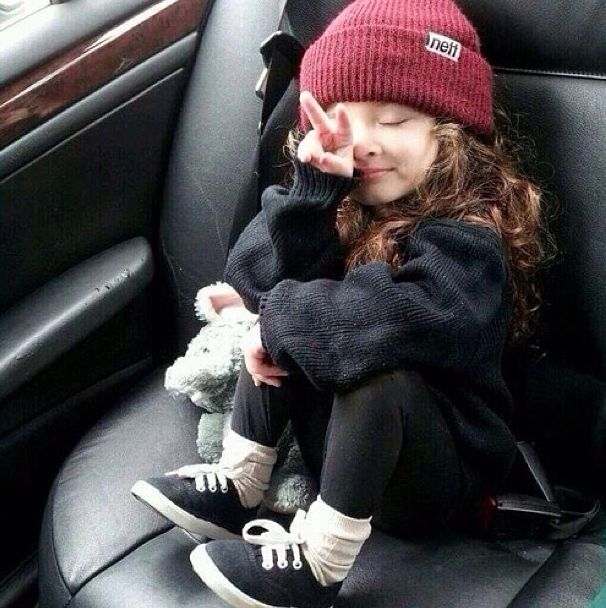 Hipster kid giving the peace sign