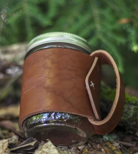 Add a dash of handsome to your morning coffee ritual with this leather mug wrap. It hugs your Mason jar to keep your hands burn free and take hot or cold drinks on the road. Just remember to screw on the top before hopping in the car or on the train to avoid spills.