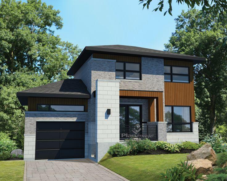 L'apparence de cette maison à étage revêtue de briques, de pierres et d'aluminium est rehaussée par le porche qui surplombe l'entrée.