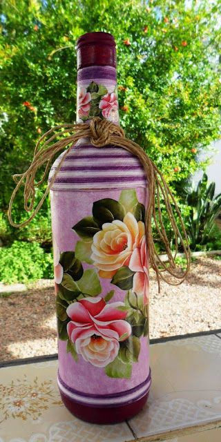 Decorated bottle with decoupage by Carlos Rossi                                                                                                                                                     Mais