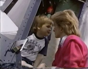 A young Prince William giving Princess Diana a kiss. GIF