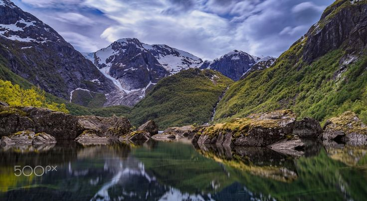 """Glacier Valley - The beautiful Bondhus valley in Folgefonna national park, fresh melt water from the glacier gathers in the calm lake, the scattered boulders churned from the surrounding mountains make for more interesting shot :-)  Appreciate if you follow me <a href=""""https://www.facebook.com/dslr.no"""">on facebook.</a> Or visit <a href=""""http://dslr.no"""">my webpage.</a>"""