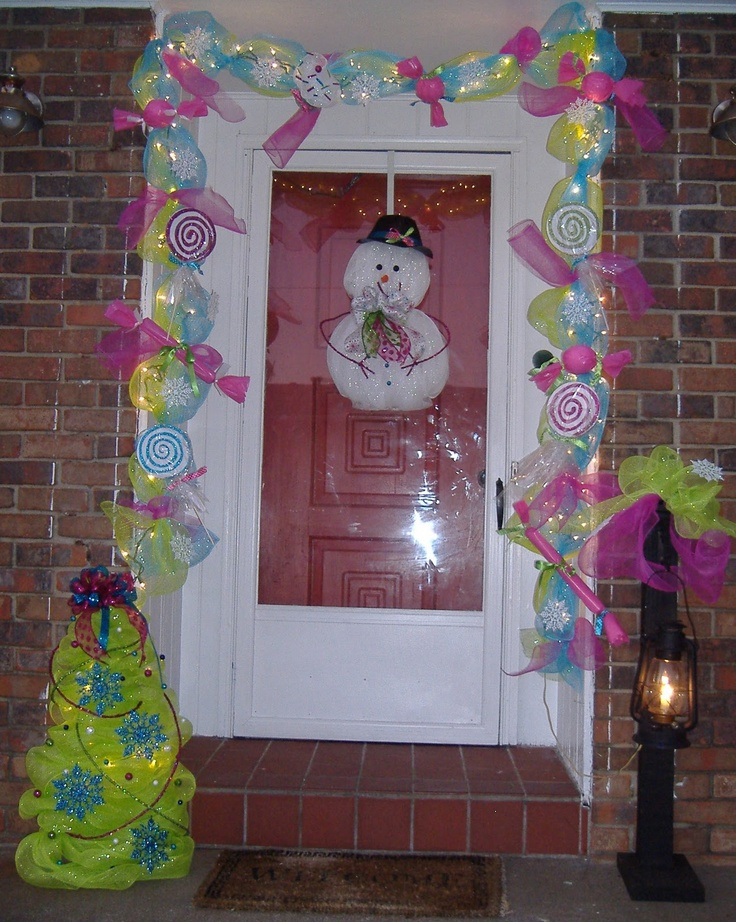 Christmas door-love the garland. door candyland
