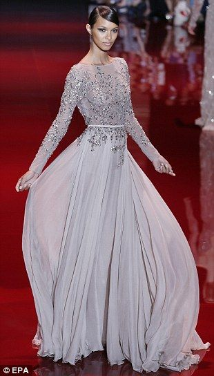 Stunning: A voluminous gown in delicate dove grey is lifted with sequins