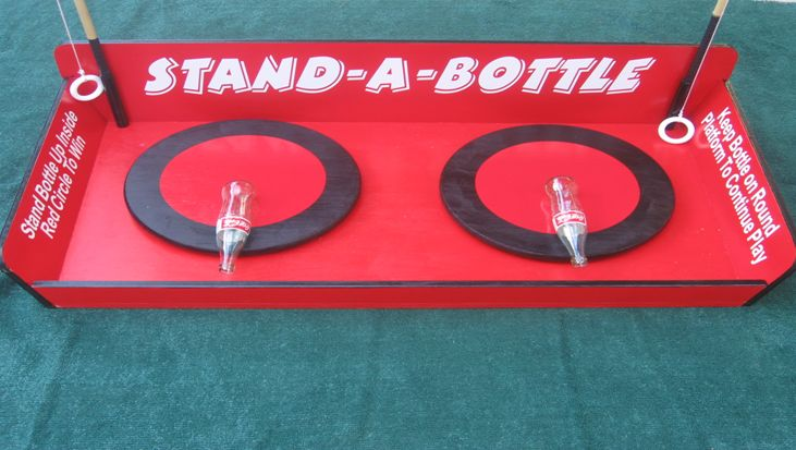 stand a bottle ... loop ring over lip of bottle