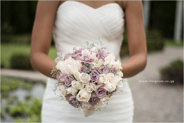Bridal bouquet in cream and lilac. Flowers and decor by Decor Mechanics