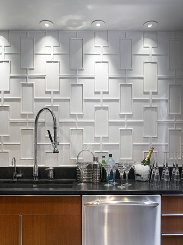 Fantastic wall application becomes the focal point of this bar.