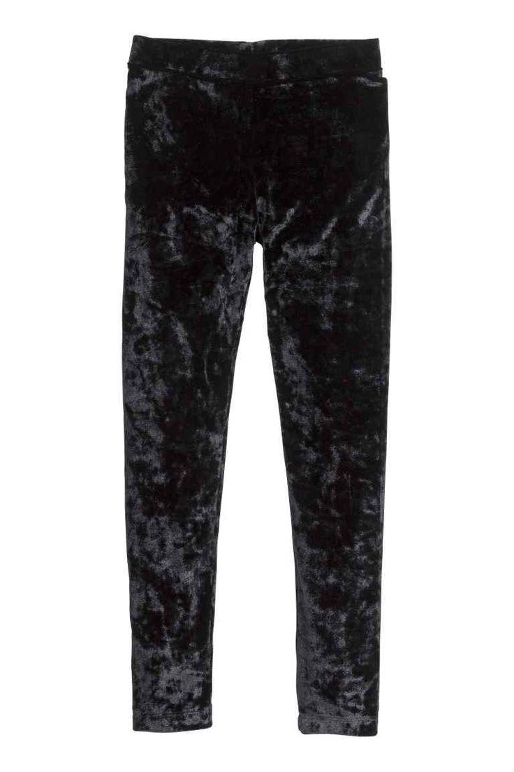 Fluwelen legging: Een fluwelen legging met elastiek in de taille.
