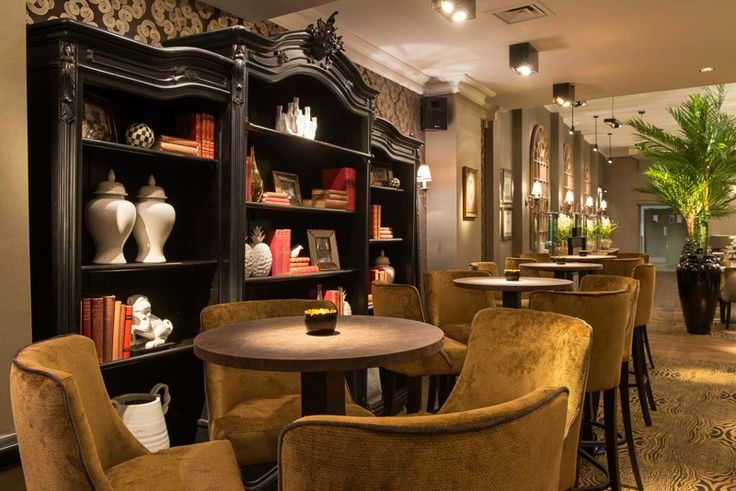 The bar area, with bespoke upholstery to compliment the scheme.
