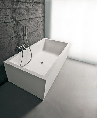 ::BATHROOMS:: Biblio 12/13 Designed by Nevio Tellatin. Rectangular Corian bath tub, complete with regulating feet and drain with pressure plug. love the concrete & frameless glazing wall #bathrooms