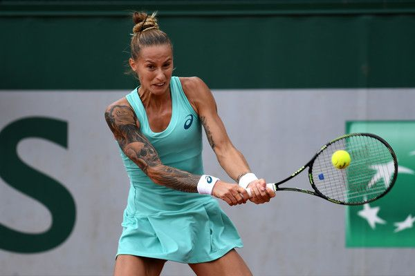 Polona Hercog Photos Photos - Polona Hercog of Slovenia plays a backhand during the Women's Singles second round match against Barbora Strycova of the Czech Republic on day four of the 2016 French Open at Roland Garros on May 25, 2016 in Paris, France. - 2016 French Open - Day Four