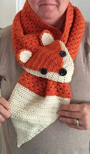This is a crochet pattern for a fox scarf. The size is adult, but can easily fit teens and pre-teens, and the length can be changed to suit your needs.