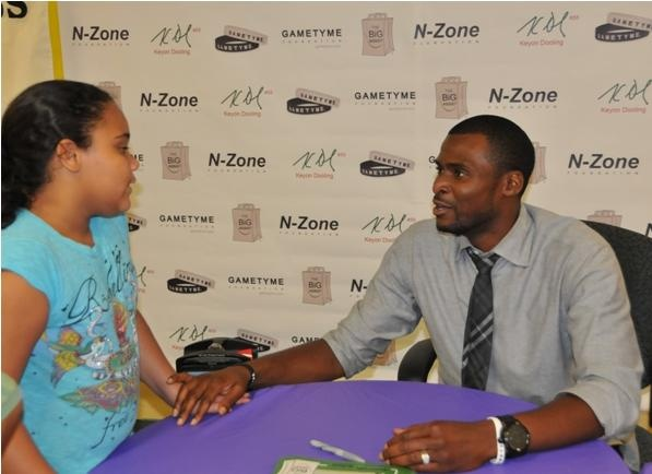 Keyon Dooling signs autographs for children at The BIG Assist