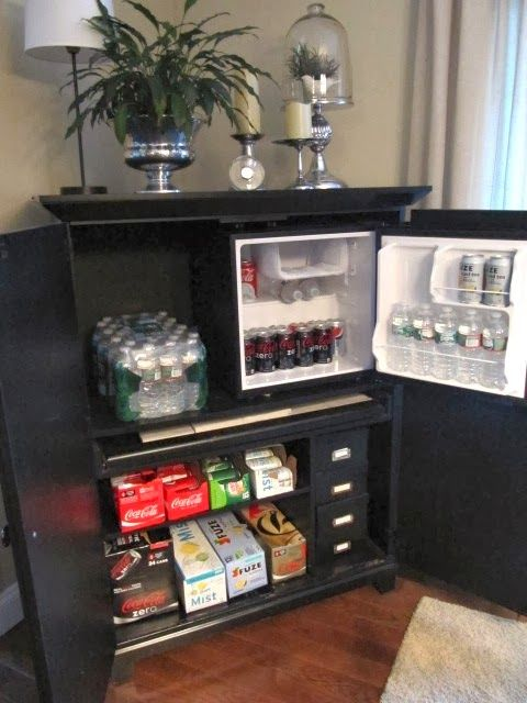 computer desk turned beverage cabinet – perfect in the basement. Maybe find a spot for a small microwave. Perfect for kids and their friends.