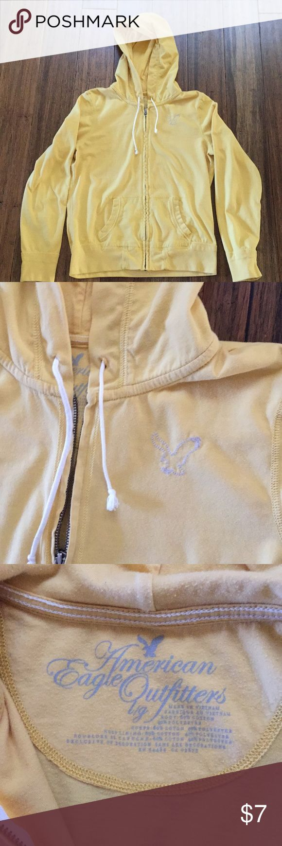 American Eagle yellow zip up hoodie size L Yellow American Eagle Outfitters zip up hoodie. Size Large. Small stain on the bottom back of hoodie American Eagle Outfitters Tops Sweatshirts & Hoodies