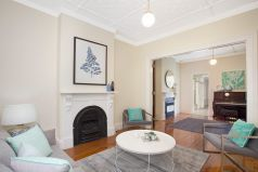 Formal sitting area, original fireplace, wall art, styled, rug. piano room