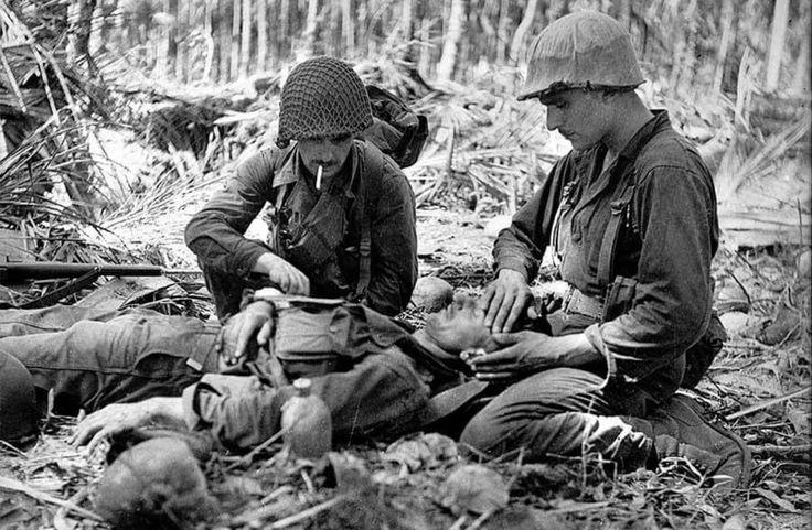 New guinea Buna 28th  November 1942. 2 marines help tend a wounded Australian
