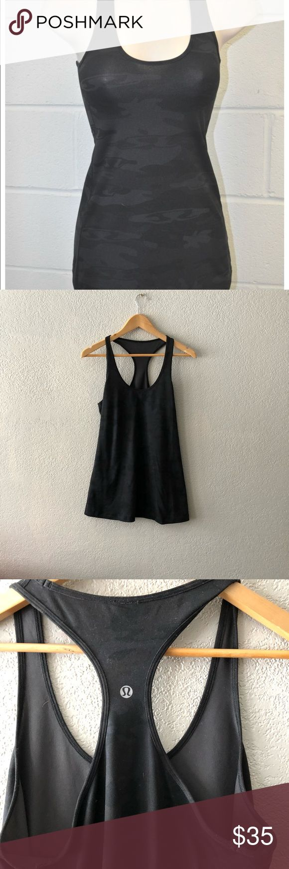 LuluLemon black camo tank top size 12 Excellent condition!!!  Approximately 18 inch bust, 29.5 inches long All measurements taken laying flat lululemon athletica Tops Tank Tops