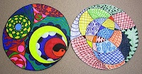 create a circle.  inside that circle, there needs to be 3-4 inner circles of different sizes.  3-4 curved lines intersecting other lines. 5-6 different designs in all...a different motif in each section.  may use black and white or colored pencils, markers.