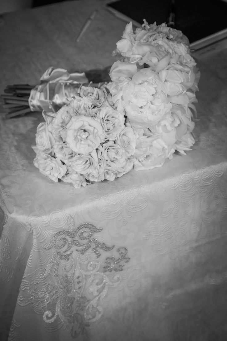 Bride's Bouquet with white peonies, and Bridesmaid's Bouquet with champagne sahara roses and white peonies. http://www.fusion-events.ca/